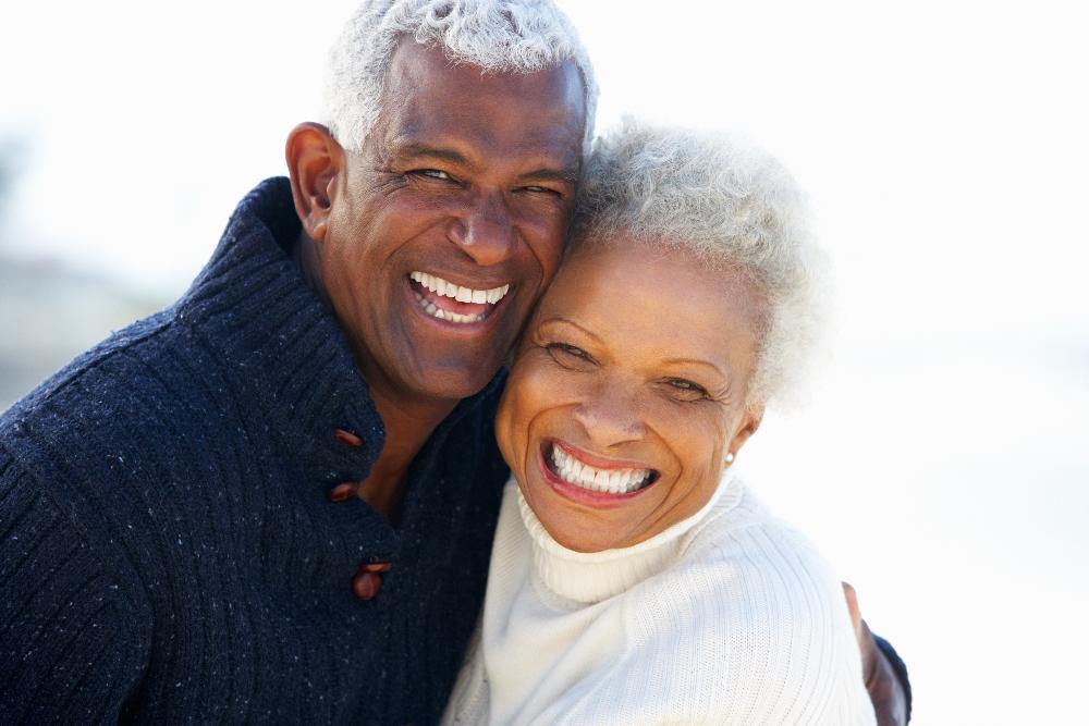 Happy couple smiling wearing dental implants in Springfield MO