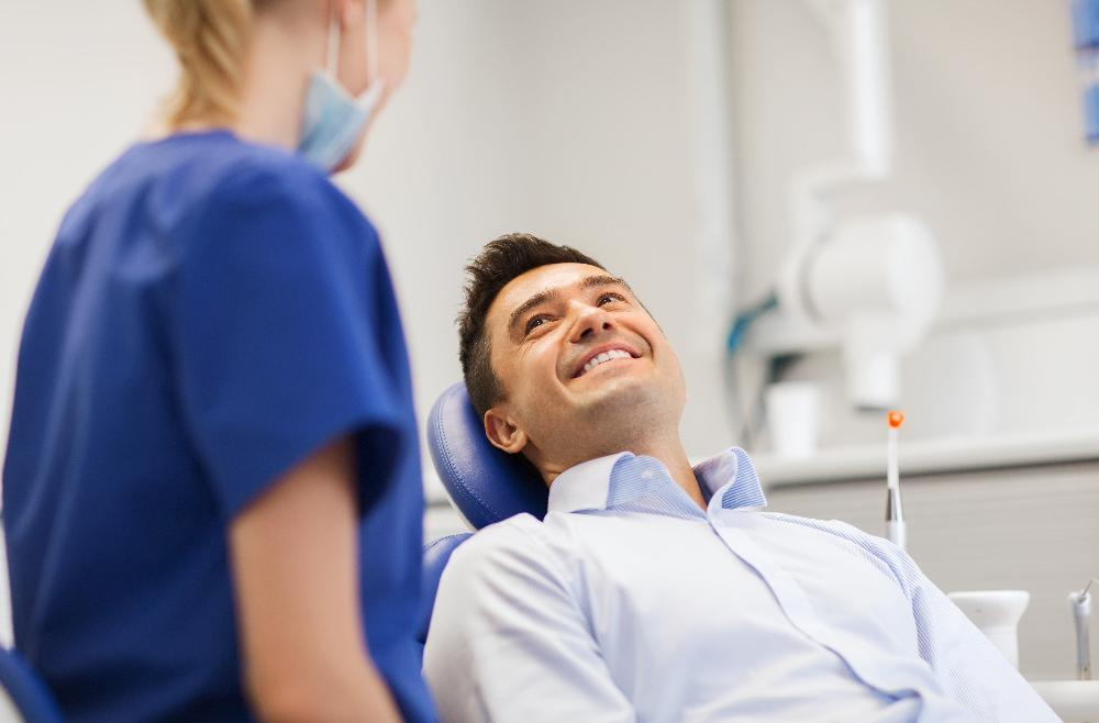 Man smiling in treatment chair for root canal therapy in Springfield MO