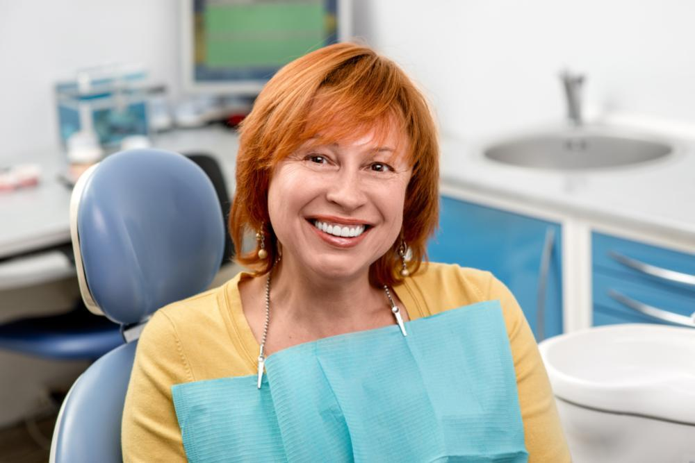 a woman smiles in the dental chair | preventive dentist springfield mo