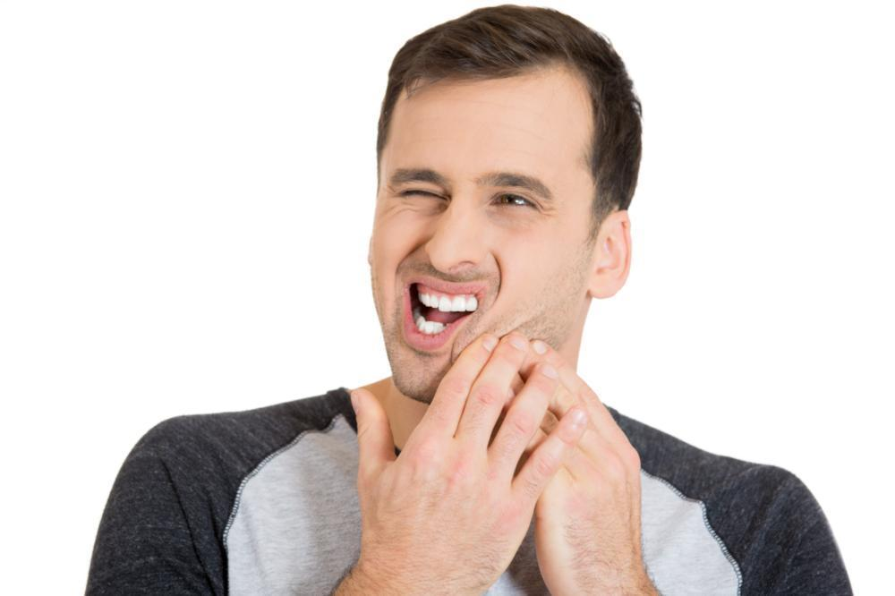 a man holds his jaw in pain | emergency dentist springfield mo