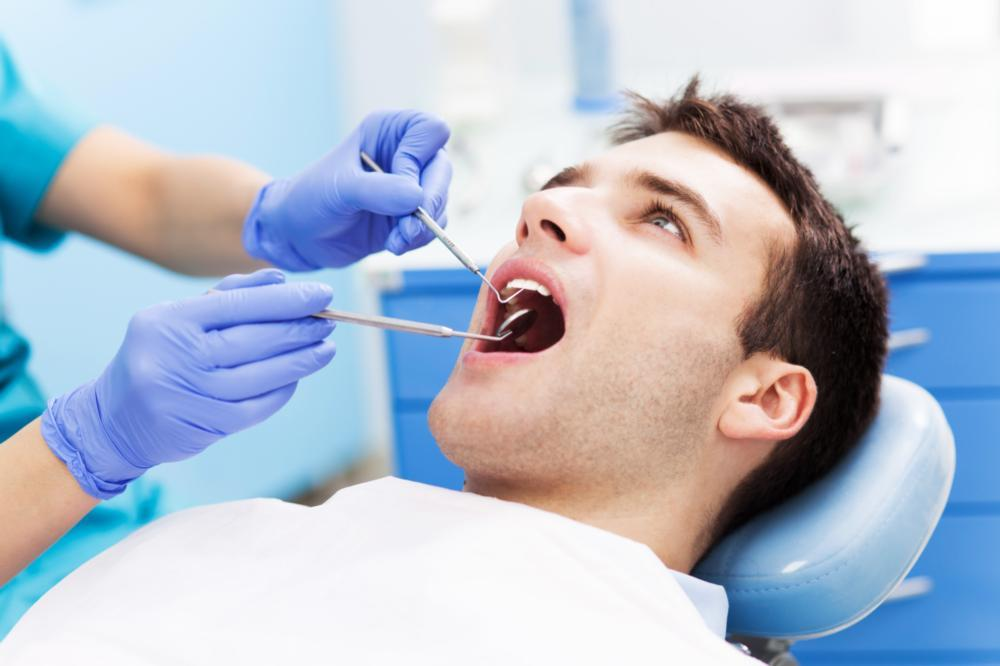 a man is worked on by the dentist | springfield mo preventive dentist