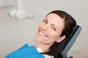 a woman smiles in the dental chair | root canal therapy in springfield mo