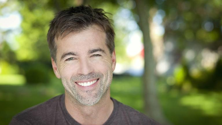 a man smiles outside | cosmetic dentist southeast springfield